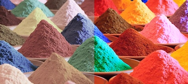 Piles of brightly multicoloured sand showing Triluminos PRO colour range