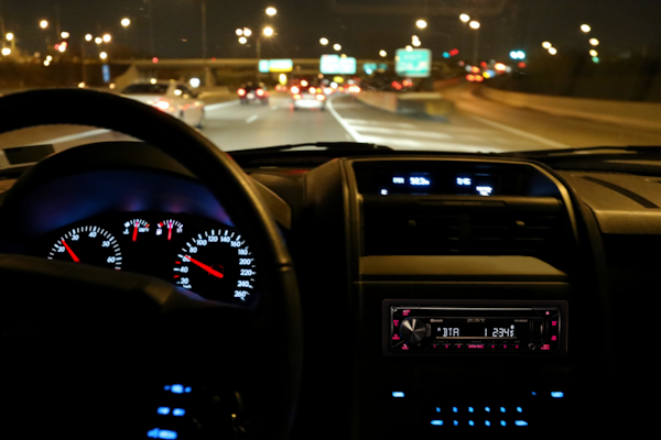 Night-time shot of the MEX-N4300BT coloured display matching the car's dashboard