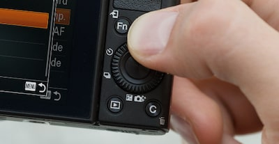 Close-up of hand accessing controls of the Sony DCS-RX100 III Cyber-shot™ digital camera