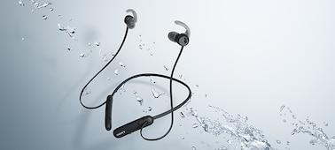 WI-SP510 headphones in black being splashed with water