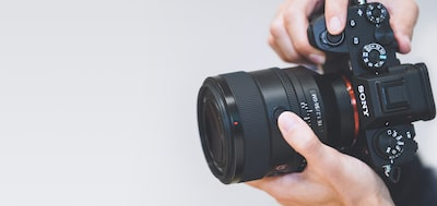 Image of a camera being held vertically with the FE 50‑mm F1.2 GM lens attached